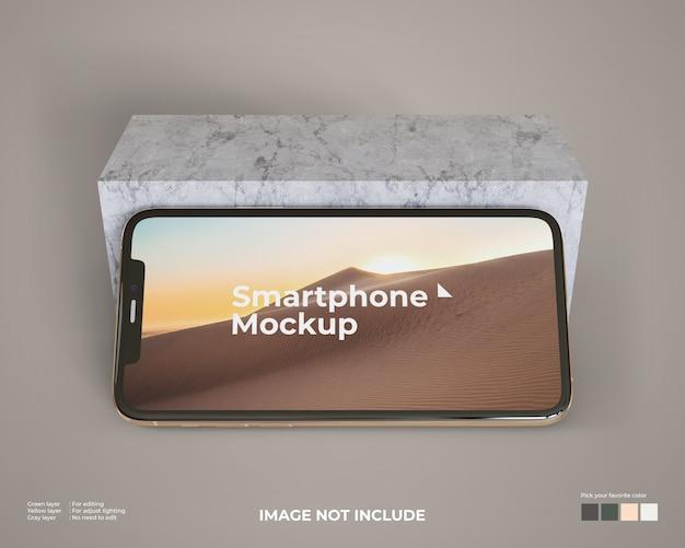 Landscape smartphone mockup met een marmeren blok Premium Psd