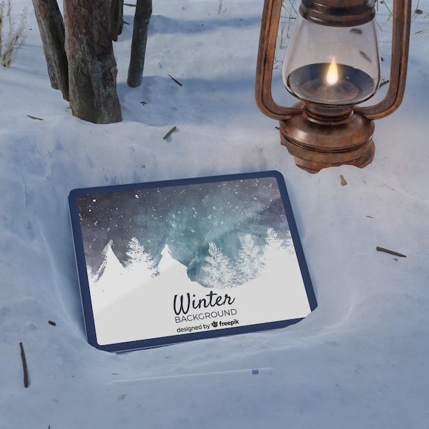 Lanterna e tablet sulla scena congelata Psd Gratuite