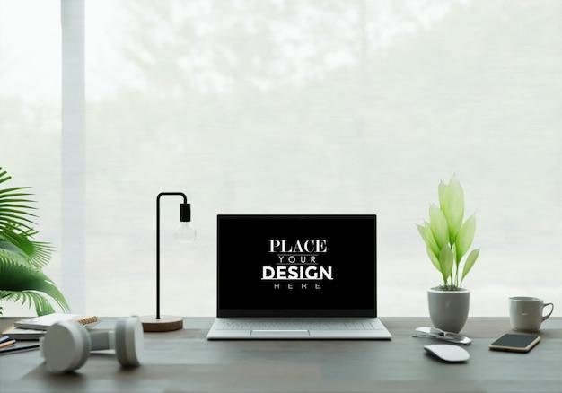 Laptop en escritorio en maqueta de espacio de trabajo PSD gratuito
