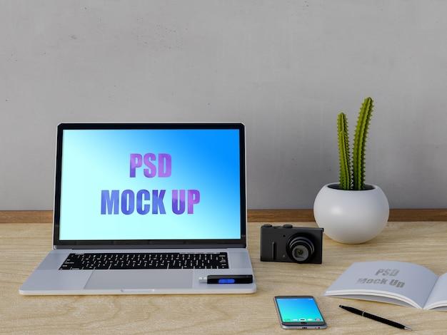 Laptop mockup en smartphone op tafel Premium Psd