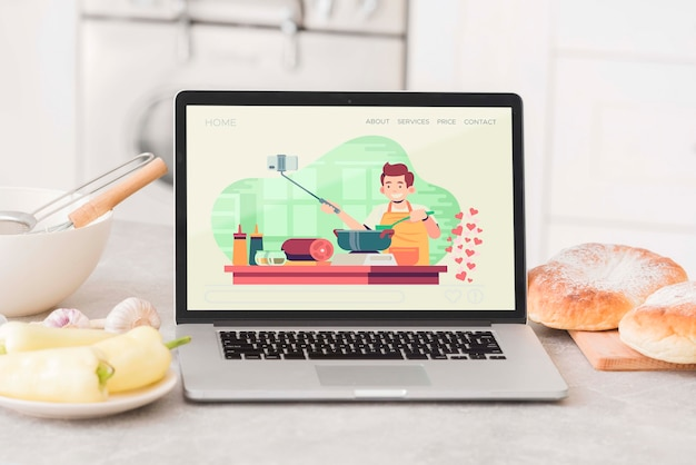 Laptop op de keukentafel Gratis Psd