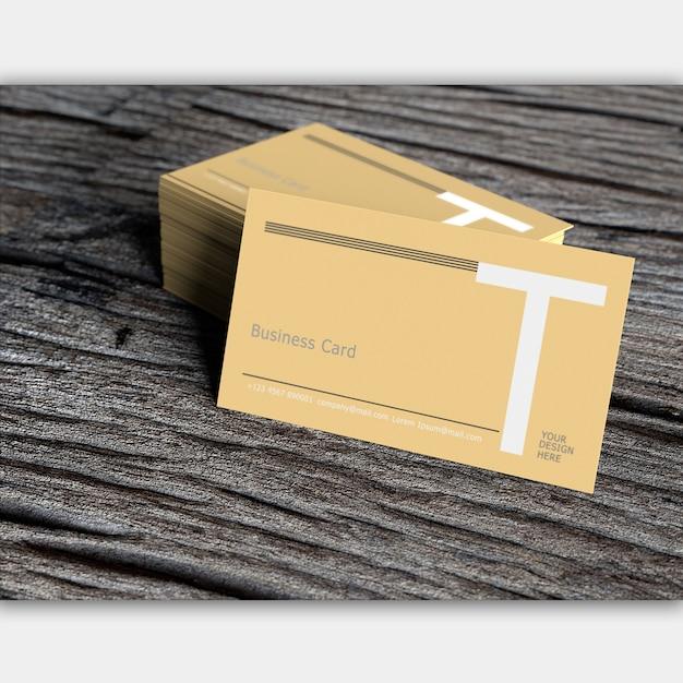 Leeg visitekaartje op oud donker hout Premium Psd