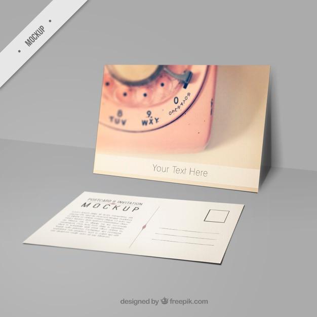 Leuke mockup briefkaart met een foto van roze telefoon Gratis Psd