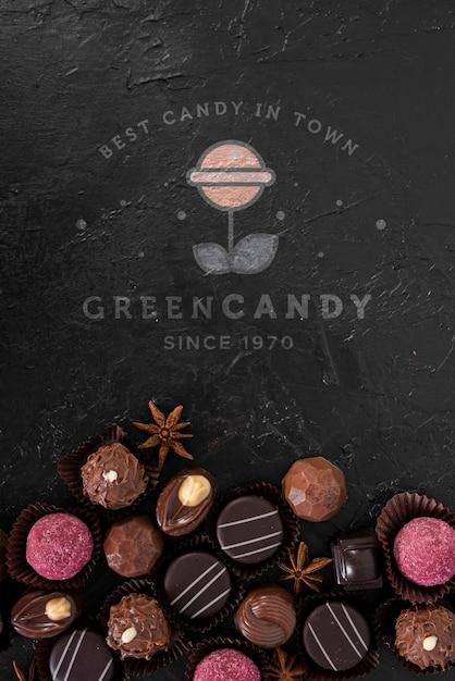 Logo di caramelle verdi mock-up con praline Psd Gratuite
