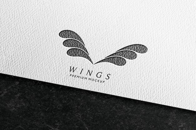 Logo mockup in wit papier met potlood textuur Premium Psd