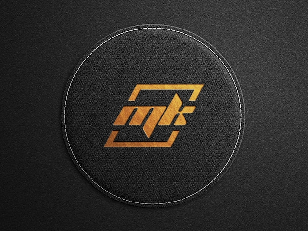 Logo mockup op afgerond zwart lederen oppervlak met inscriptie goudopdruk Premium Psd