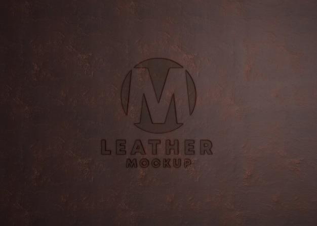 Logo mockup op leder texture Premium Psd
