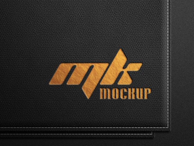 Logo-mockup op zwart leer met goudopdruk in reliëf Premium Psd