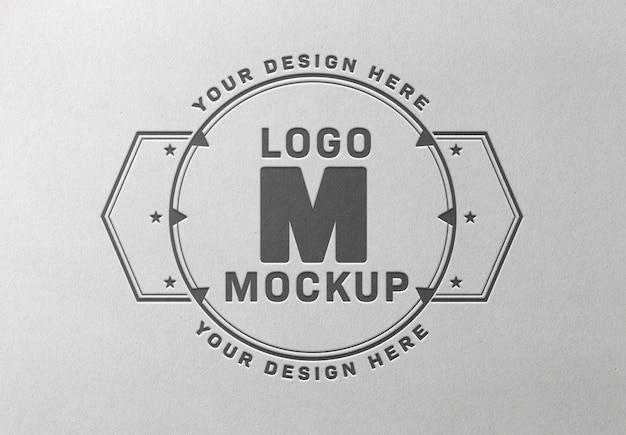 Logo pressato mockup sulla trama del libro bianco Psd Premium