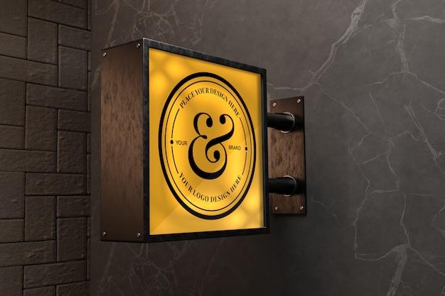 Logo teken mockup op zwart marmeren muur Premium Psd
