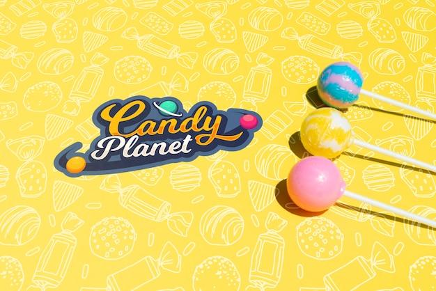 Logotipo de candy planet con planetas de azúcar de piruleta PSD gratuito