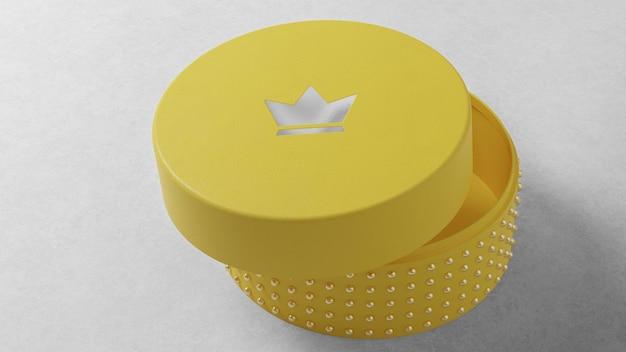 Luxe logo mockup op ronde gele sieraden horlogedoos Premium Psd