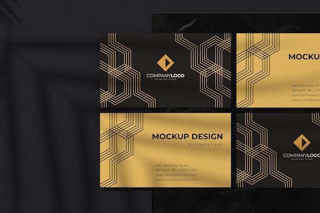 Luxe zwart visitekaartje ontwerp mockup met gouden geometrische lijnen Premium Psd