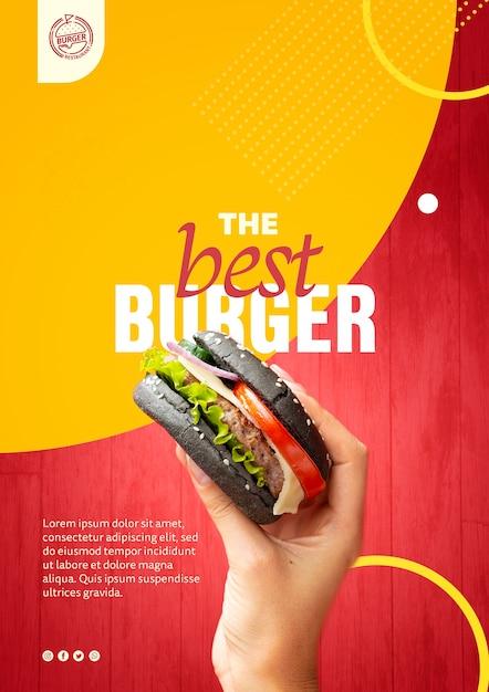 Mano che tiene il modello di hamburger panino nero Psd Gratuite