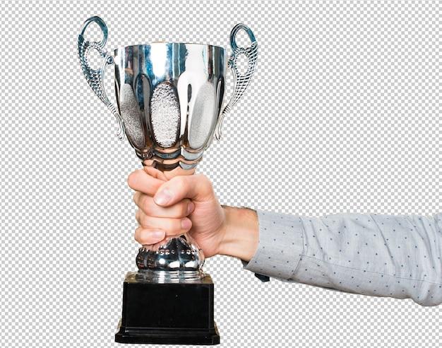 Mano dell'uomo che tiene in mano un trofeo Psd Premium