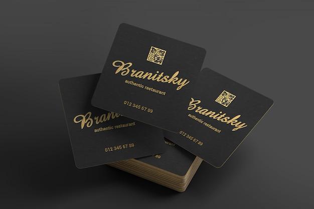 Maqueta creativa de tarjetas de visita cuadradas en negro y dorado PSD Premium