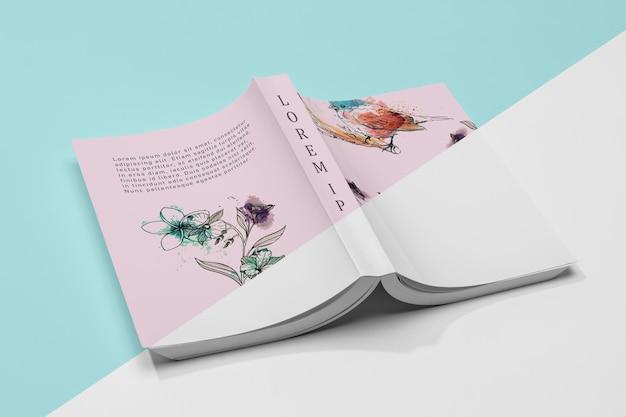 Maqueta de libro abierto volteado en ángulo alto PSD gratuito