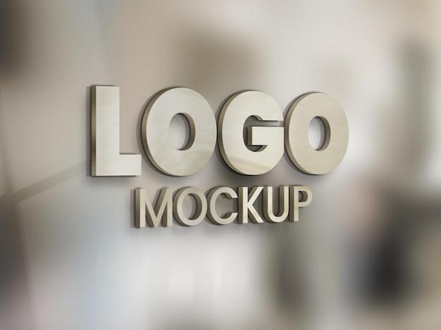 Maqueta de logo en panel sobre vidrio de oficina PSD gratuito