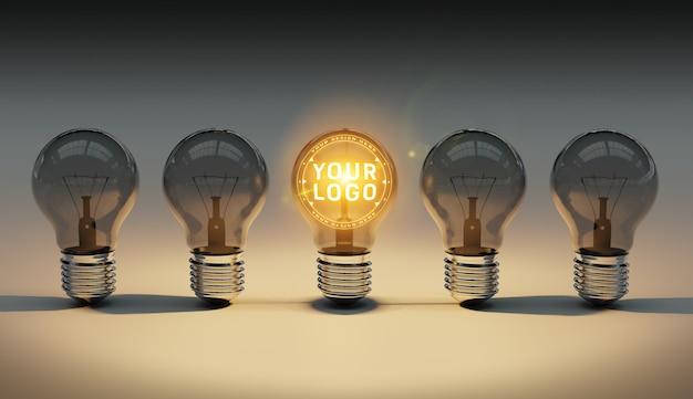 Una maqueta de logotipo de bombillas brillantes tirado en el piso PSD Premium