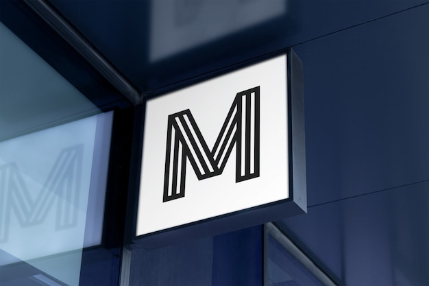 Maqueta de logotipo cuadrado moderno colgante signo en fachada de edificio corporativo en marco negro PSD Premium