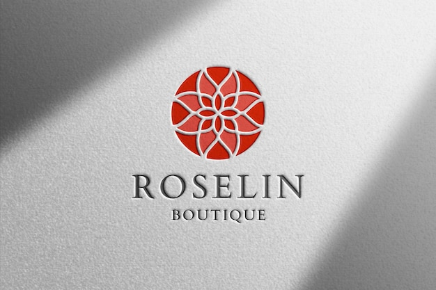 Maqueta de logotipo realista sobre papel blanco PSD Premium