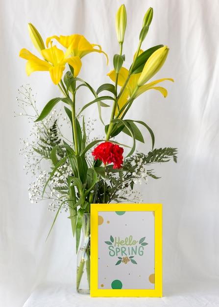 Maqueta de marco con flores de primavera PSD gratuito