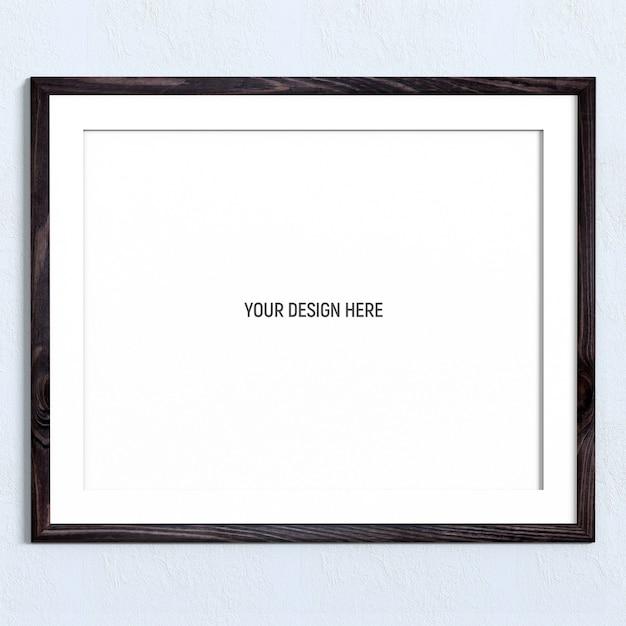 Maqueta de marco de madera oscura horizontal en pared con textura blanca PSD Premium