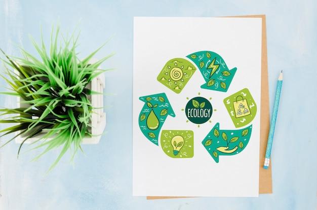 Maqueta de papel de papelería plana con planta PSD gratuito
