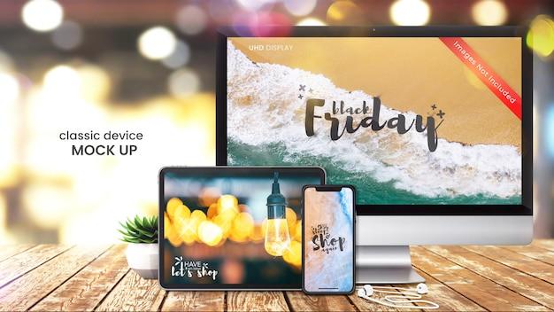 Maqueta perfecta de píxeles de la pantalla de la computadora, teléfono inteligente y tableta digital en la mesa de la tienda brillante PSD Premium