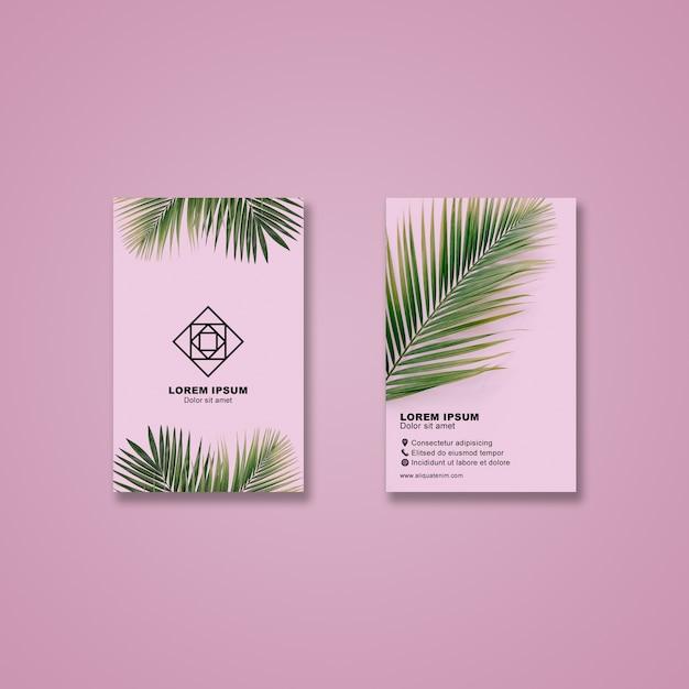 Maqueta de tarjeta de visita con hojas tropicales PSD gratuito