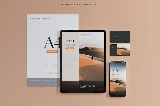 Maquetas de teléfonos inteligentes y tabletas con tarjetas de visita PSD gratuito