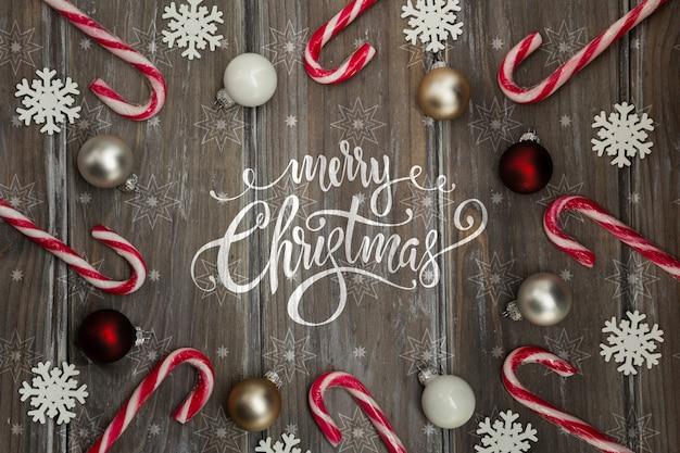 Marco de bastón de caramelo con mensaje de navidad PSD gratuito
