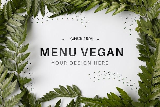 Menu vegano di vista dall'alto concetto con mock-up Psd Gratuite