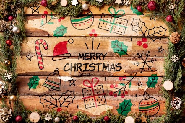 Merry christmas belettering mock-up op houten achtergrond Gratis Psd