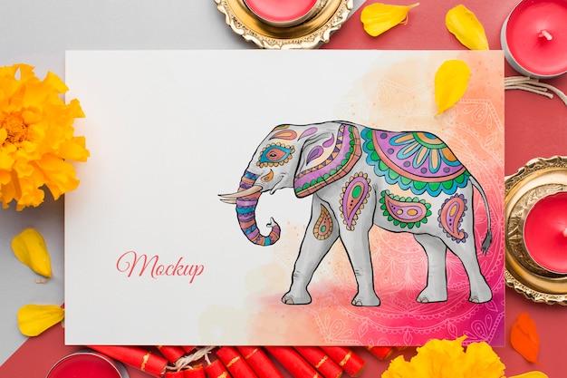 Mock-up diwali hindoe festival olifant en bloemen Gratis Psd