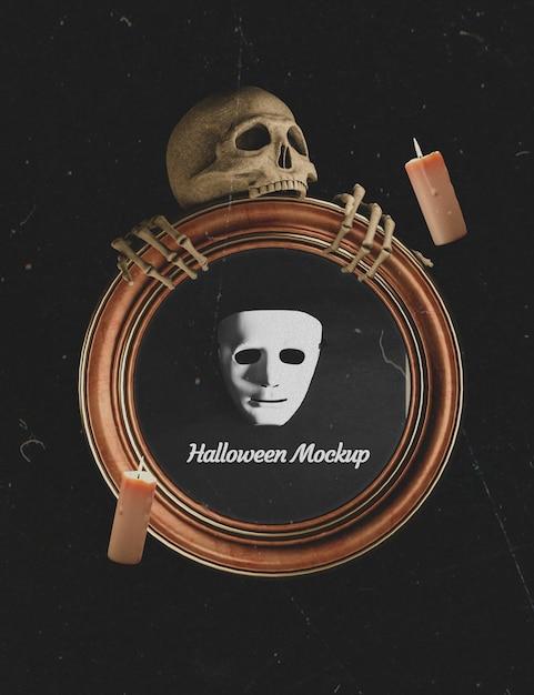 Mock-up frame wordt vastgehouden door een halloween skelet Gratis Psd