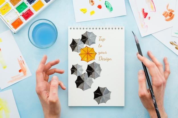 Mock-up notebook met realistische tekening Gratis Psd