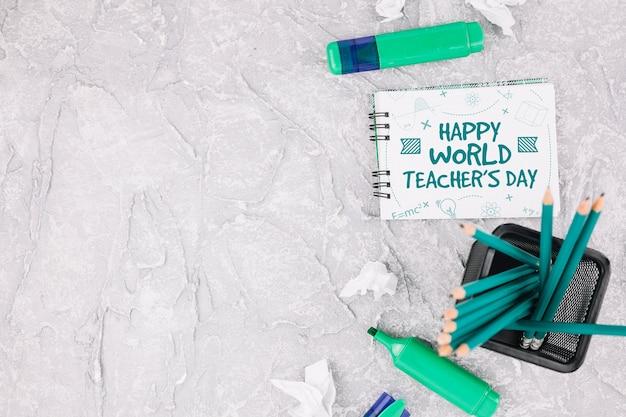 Mock-up van de werelddagleraar met boekje Gratis Psd