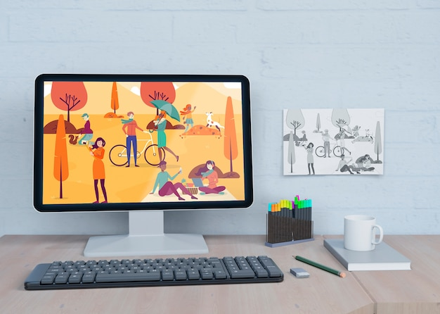Mock-upmonitor met kleurrijke tekening Gratis Psd