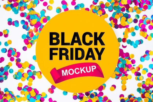 Mockup de black friday con confeti PSD gratuito