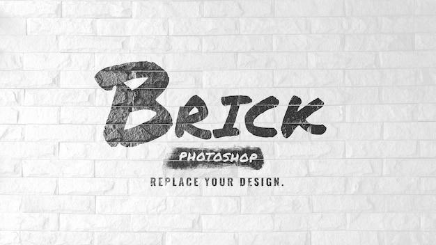 Mockup brush logo op witte bakstenen muur Premium Psd