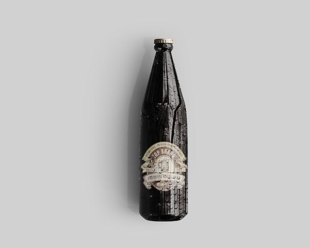Mockup della bottiglia di birra di vetro ambrato con le gocce di acqua - vista superiore Psd Premium