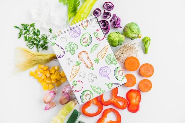 Mockup di blocco note con il concetto di cibo sano Psd Gratuite