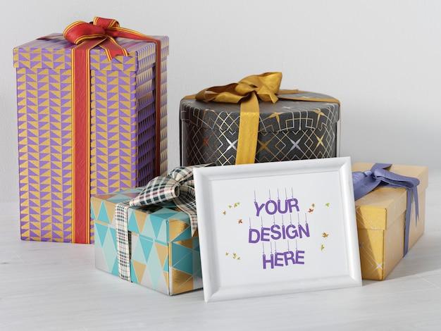 Mockup di cornice di festa con scatole regalo e nastro Psd Premium