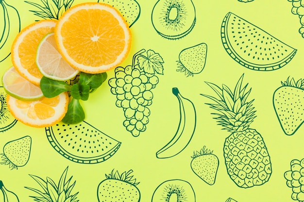 Mockup di estate piatta laici con copyspace e fette d'arancia Psd Gratuite