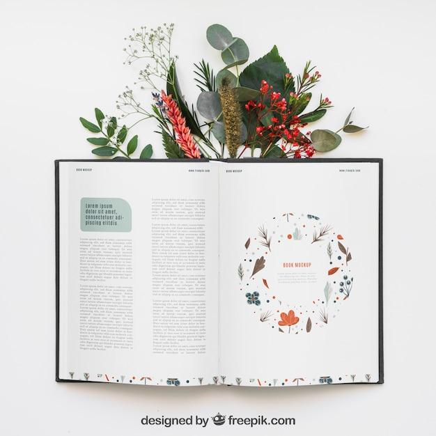 Mockup di libro aperto con foglie Psd Gratuite