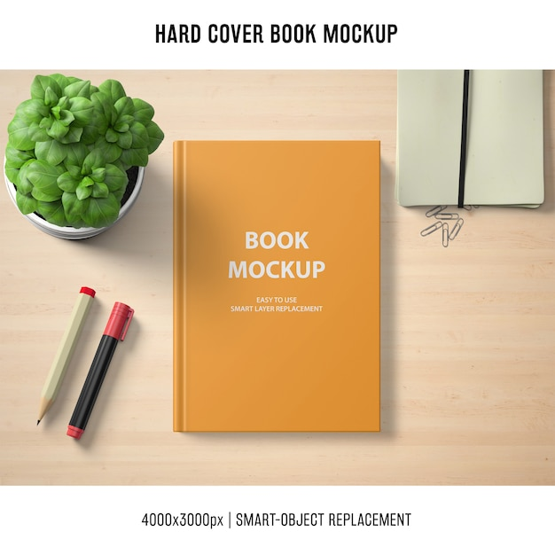 Mockup di libro con copertina rigida con basilico Psd Gratuite