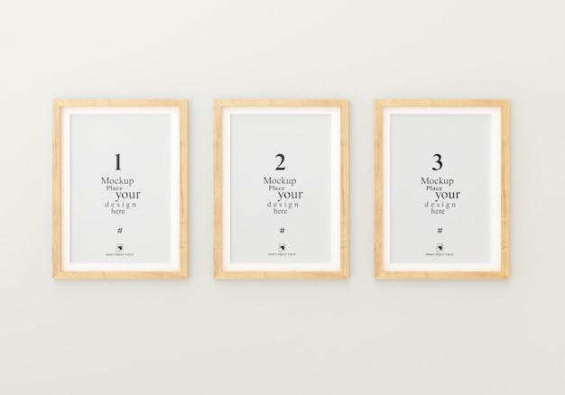 Mockup drie lege fotolijstjes voor mockup in lege witte ruimte Premium Psd