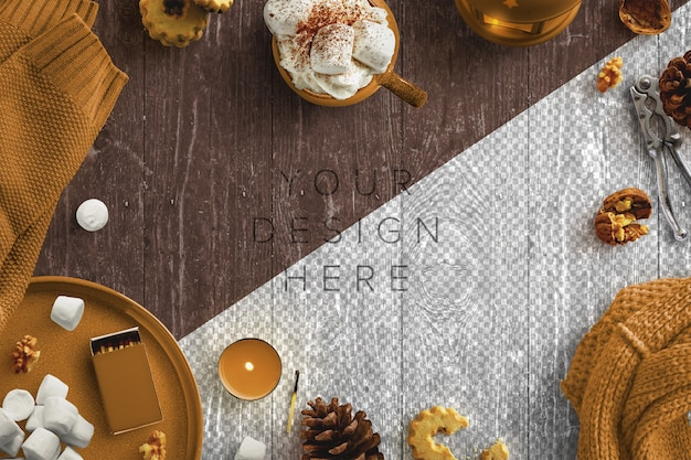 Mockup gezellige winters tafereel met kaarsen, warme drank, marshmallows, noten en wollen kleding Gratis Psd