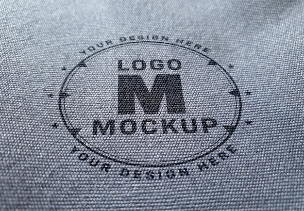 Mockup logo sulla trama del tessuto denim Psd Premium